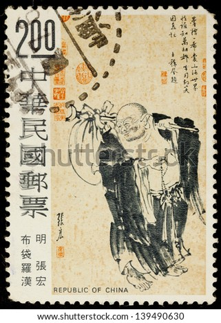 TAIWAN - CIRCA 1975: A stamp printed in Taiwan shows a monk with a bag by Zhang Hong during Ming Dynasty. The original painting is a collection in National Palace Museum, Taiwan, circa 1975