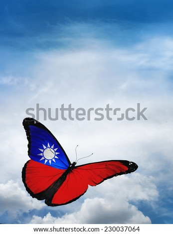 Taiwan flag butterfly flying on sky background - stock photo