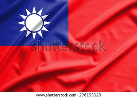 Taiwan flag on soft and smooth silk texture - stock photo