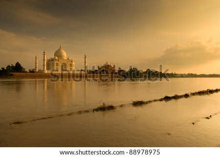 Taj Mahal, Agra, India. Romantic picture taken in sunset scene on  other side of river. - stock photo