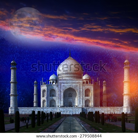 Taj Mahal by the light of the full moon in Agra, Uttar Pradesh, India. Elements of this image furnished by NASA. - stock photo