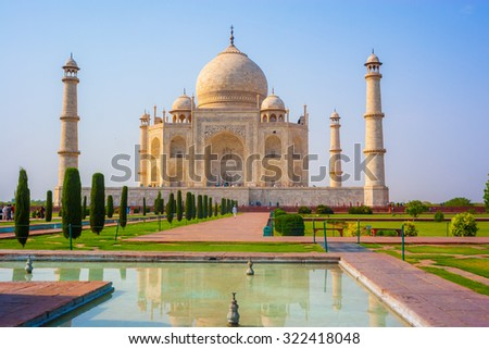 Taj mahal front view,reflection in water - stock photo