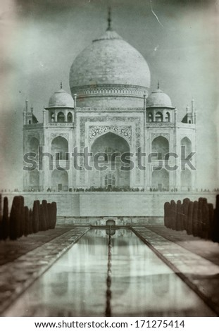 Taj Mahal in India. Old retro-styled film imagery stylization with grain and scratches - stock photo