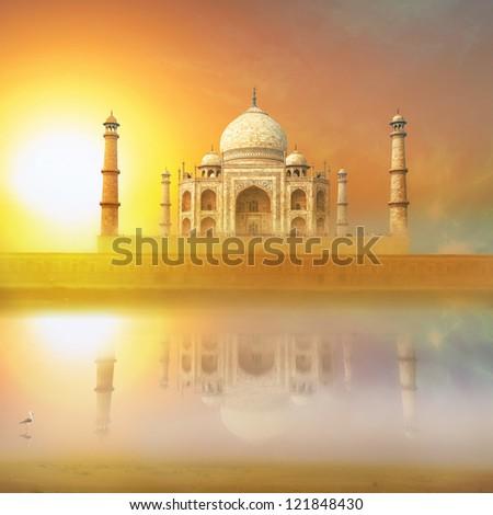 Taj Mahal India Sunset. Agra, Uttar Pradesh. Beautiful Palace with reflection in river. Wonderful landscape. - stock photo