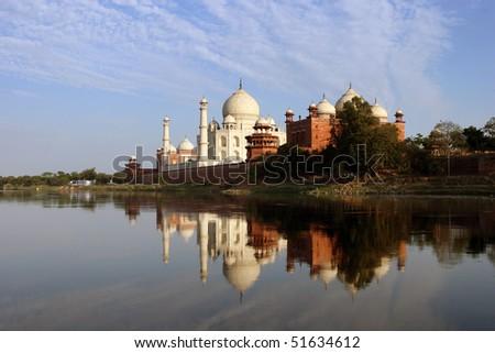 Taj Mahal mirrored in a river - stock photo