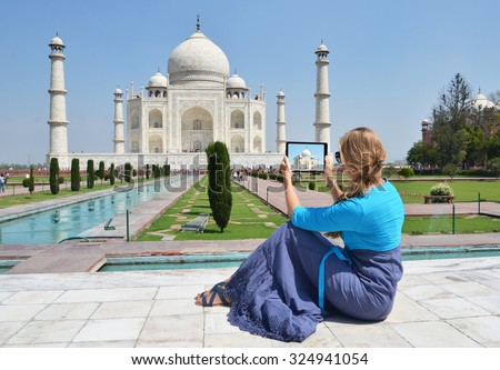 Taj Mahal on the screen of a tablet. Agra, India - stock photo