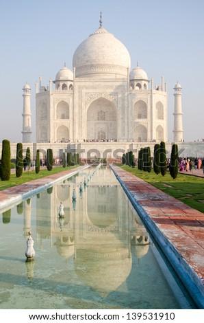 Taj Mahal reflecting in fountain - early morning in Agra, India - stock photo