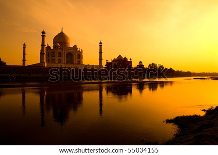 Taj Mahal silhouette from the banks of the Yamuna river - stock photo