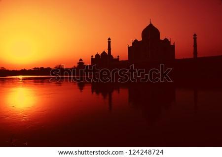 Taj Mahal sunrise reflection in River - stock photo