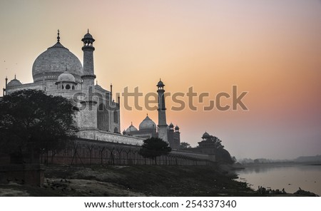 Taj Mahal sunset view from the banks of the Yamuna river. Agra. India - stock photo