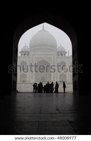 Taj Mahal through the arch - stock photo