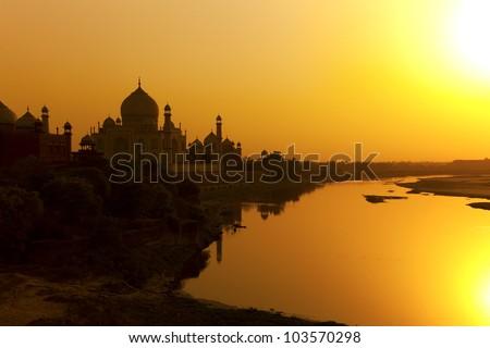 Taj Mahal with the Yamuna river at sunset. India. - stock photo