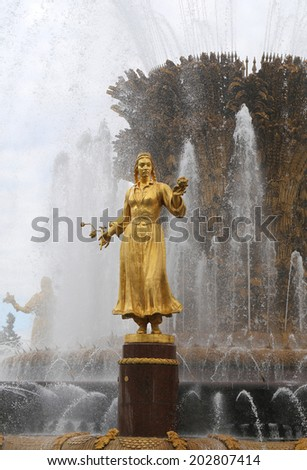 Tajik girl gilded sculpture fountain in moscow stock photo