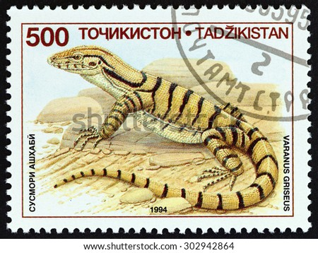 "TAJIKISTAN - CIRCA 1995: A stamp printed in Tajikistan from the ""Native Lizards "" issue shows Transcaspian desert monitor (Varanus griseus), circa 1995."