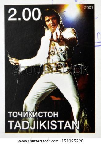 TAJIKISTAN - CIRCA 2001: stamp printed in Tajikistan shows Elvis Presley, circa 2001  - stock photo