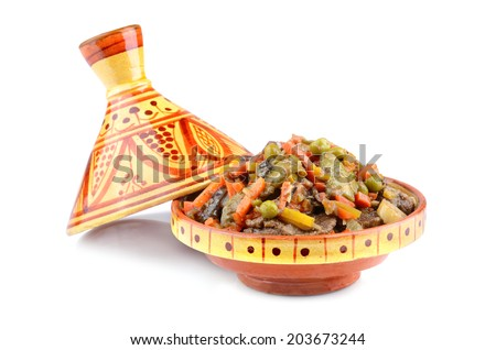 Tajine, Moroccan national dish with meat and vegetables on a white background