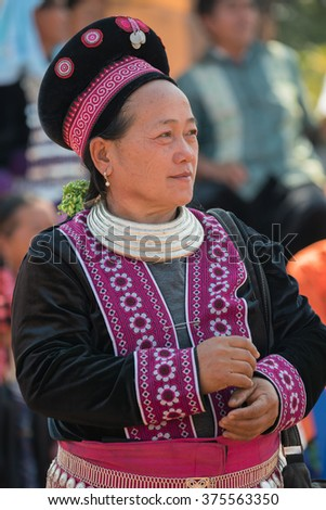 "TAK PROVINCE, THAILAND - FEB 10, 2016 : Unidentified Muser hill tribe women in traditional clothes pose and look at camera in ""Hill Tribes New Year Festival"" Tak, Thailand on February 10 ,2016."