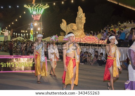 TAK, THAILAND - NOV 21, 2015 : Loy Krathong Sai festival. Unidentified people dancing in traditional dress parade at the opening Loy Krathong Sai festival Tak Province ,Thailand.
