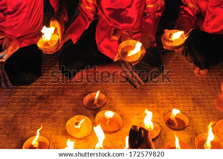 TAK, THAILAND - NOV 26: Unidentified people traditional dance with lantern make from coconut shell Loy Kra Thong Sai  Fesival on November 26, 2012 on Ping River, Amphur Muang, Tak, Thailand.  - stock photo