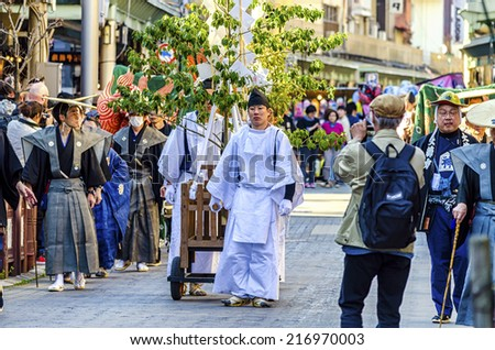 TAKAYAMA,JAPAN - 14 April,2014:Japanese shinto monk in Mikoshi procession . A portable shrine (mikoshi) is carried around the town in a parade during the two days of Takayama festival