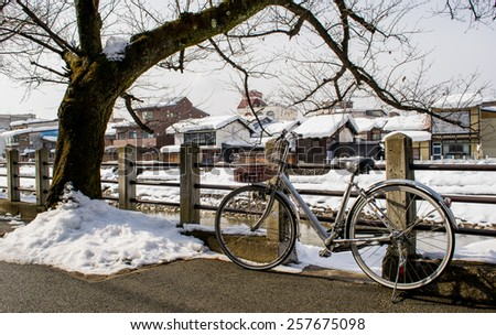 TAKAYAMA, JAPAN - JANUARY 25, 2015: This snow city on winter season have snow and ice buildup and bicycle on street TAKAYAMA old city JAPAN.