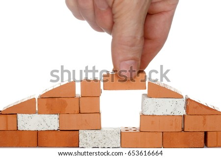 take a brick to a house wall