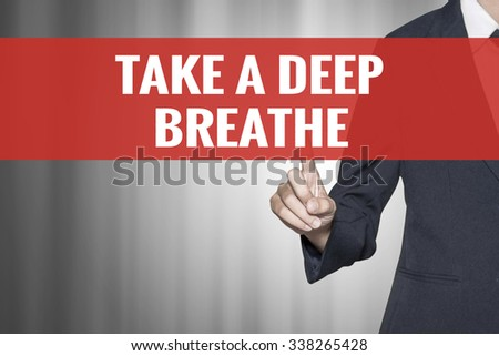 Take a Deep Breathe word on virtual screen push by business woman red tab - stock photo
