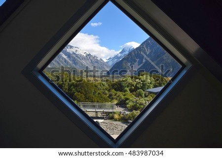 Take a look out the window of National Park Visitor Center to catch a glimpse of Mt. Cook.