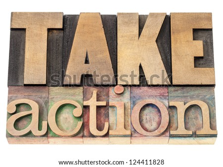 take action - motivation concept - isolated text in vintage letterpress wood type printing blocks - stock photo