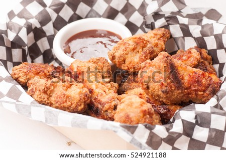 take away breaded chicken wings with bbq dipping sauce