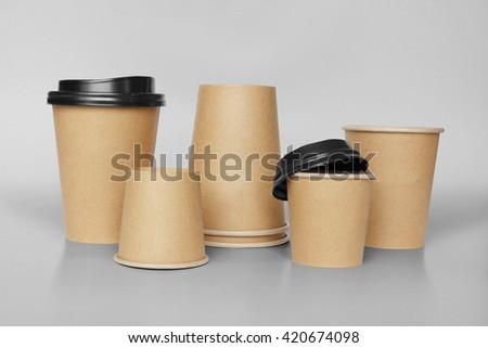 Take-away coffee in cardboard cup - stock photo