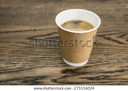 Take away Coffee on rustic wooden table - stock photo