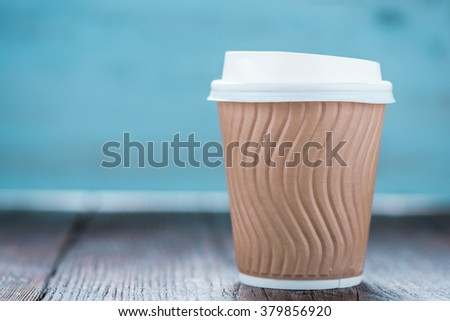 Take away coffee plastic cup on wooden background with space for text or advert - stock photo