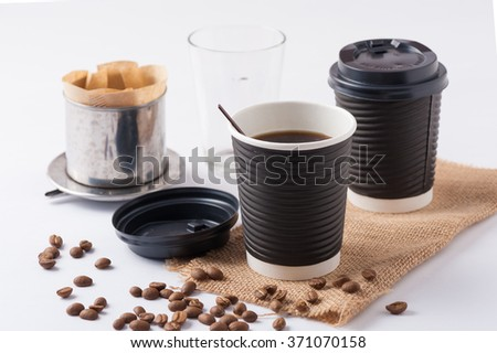 Take away paper coffee cup with metal coffee filter - stock photo