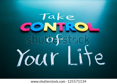 Take control of your life concept, colorful words on blackboard - stock photo