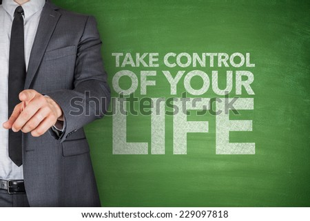 Take control of your life on blackboard with businessman - stock photo