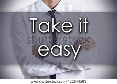 Take it easy - Closeup of a young businessman with text - business concept - horizontal image