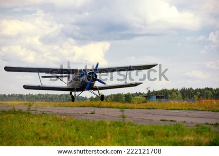 Take-off of the old Russian plane - stock photo