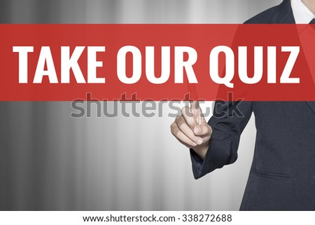 Take Our Quiz word on virtual screen push by business woman red tab - stock photo