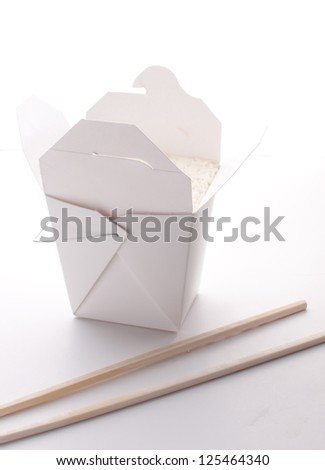 Take-out box with rice with chopsticks isolated