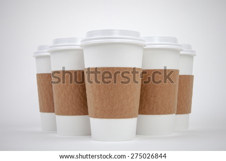 Take out paper cups with lids and holders - stock photo