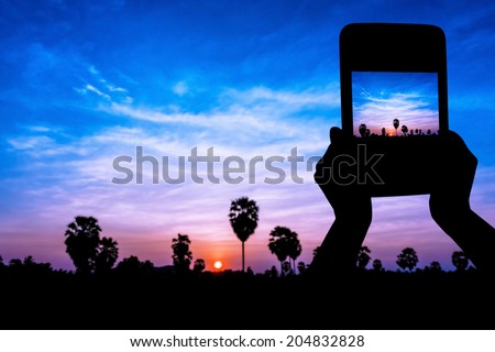 Take photo view by tablet on twilight time - stock photo