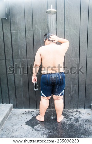 take shower after pool swim - stock photo