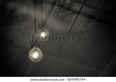 Take the bulb in the coffee shop through glass - vintage style effect picture - stock photo