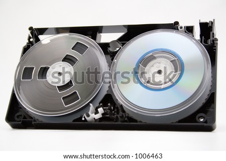 Take to pieces VHS cassette and CD disc on white background - stock photo