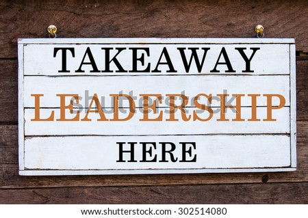 Takeaway Leadership Here Inspirational message written on vintage wooden board. Motivation concept image