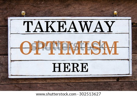 Takeaway Optimism Here Inspirational message written on vintage wooden board. Motivation concept image