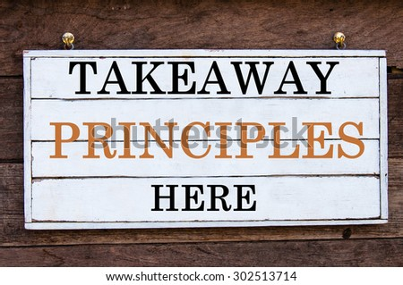 Takeaway Principles Here Inspirational message written on vintage wooden board. Motivation concept image