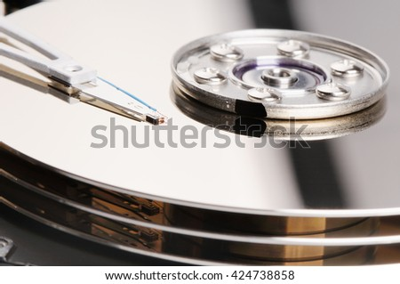 Taken apart computer hard disk drive (HDD) background - stock photo