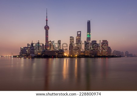 Taken from Huangpu Park on The Bund at sunrise, this was one of the clearest mornings of the year. In this iconic view of modern Shanghai, you can see Pearl Tower, Conference Centre and Shanghai Tower - stock photo